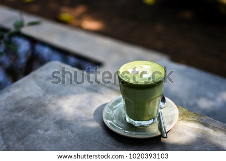 Matcha latte in the garden for add text above. #1020393103