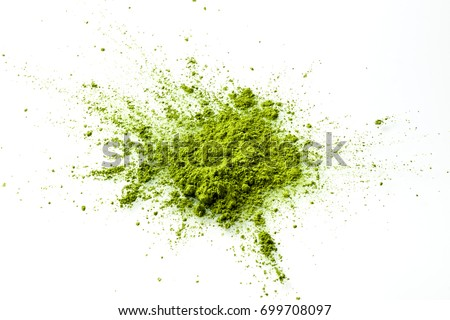 Matcha powder explosion on white background from above. Matcha is made of finely ground green tea powder. It's very common in japanese culture. Matcha is healthy due to it's high antioxydant count.