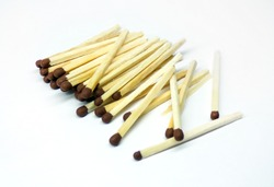 Matches are isolated on a white background. A pile of matches on a white background. Wooden matches with sulfur for lighting a fire.