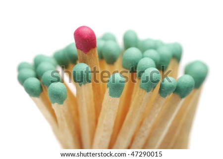 Matches closeup isolated. Red in group of green