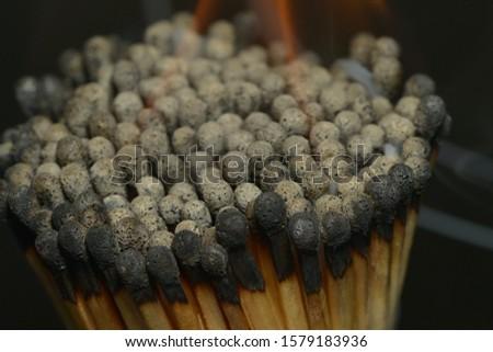 matches near,match heads,burnt matches,multi-colored match heads