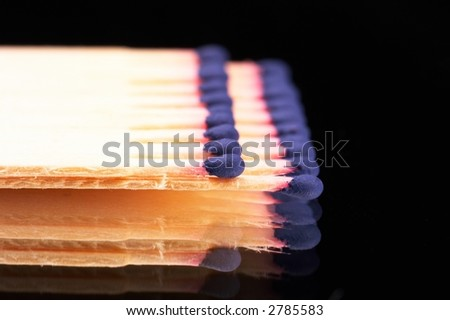 matches with blue match head in a row - landscape format - black background