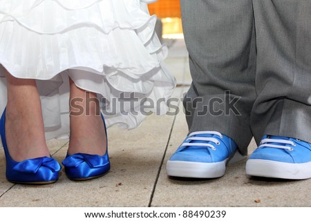 Matching Blue Shoes - Bride and Groom stand side by side with matching blue shoes