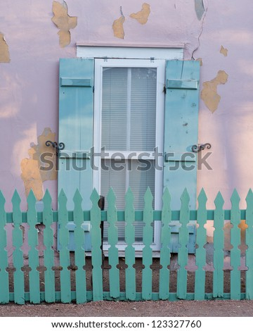 Matching green picket fence and window shutters in Santa Fe, New Mexico