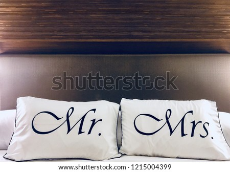 Matching white and black pillows for a just married couple, both Mr and Mrs, with a classy wooden background #1215004399
