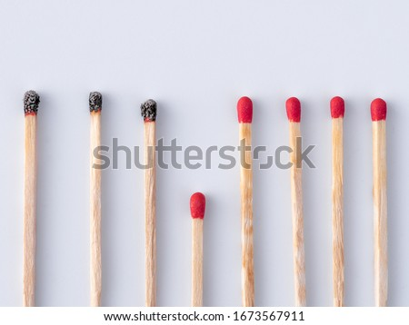 Matchsticks burn, one piece prevents the fire from spreading - the concept of how to stop the coronavirus from spreading: stay at home. Flat lay. Close up