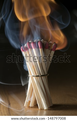 Matchsticks with a ring burning