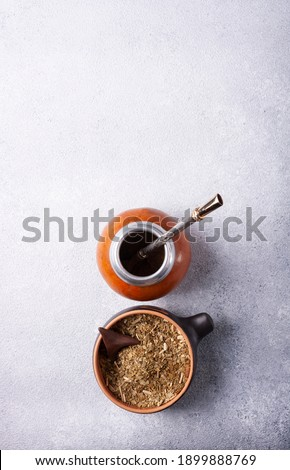 Mate, Paraguayan tea is a drink made from dried and crushed leaves of the Paraguayan holly and calabash. On a white background. Flat lay. Stockfoto ©