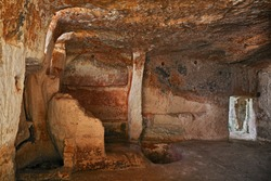 Matera, Basilicata, Italy: interior of an old cave house carved into the tufa rock in the old town (sassi di Matera)