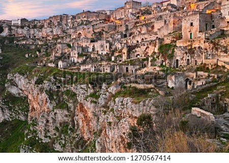 Matera, Basilicata, Italy: landscape of the old town called Sassi di Matera with the ancient cave houses carved into the tufa rock over the deep ravine