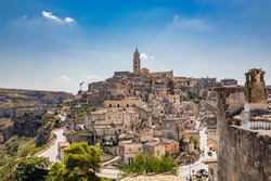 Matera, Basilicata, Italy - Panoramic view of the Civita and the Sasso Barisano. The ancient houses of stone and brick, carved into the rock. The Sassi of Matera.