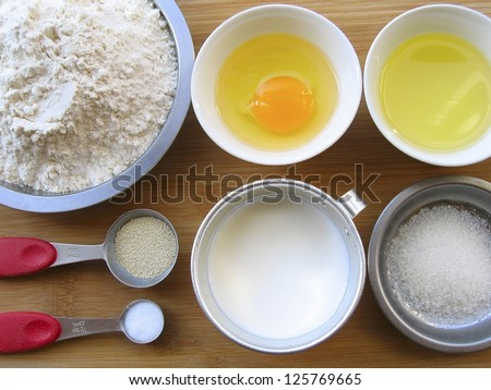 Materials of milk bread -- flour, egg, melted butter, yeast, salt, sugar and milk.