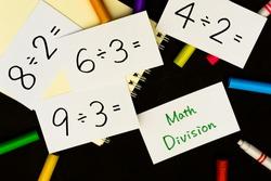 Math Division A Sketchbook and pens on Black Background