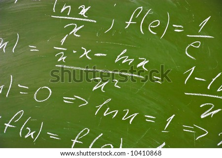 Math formulas on school blackboard.