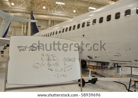 math formulas on white board at a facility for training aircraft occupations.