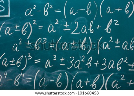 Math formulas written on the desk - stock photo