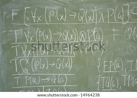 Math formulas written on the desk in classroom