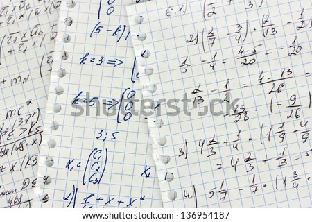 Math, physics and geometry on copybook page closeup