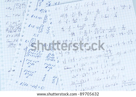 Math, physics and geometry on copybook page isolated on white - stock photo