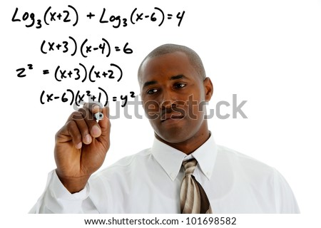 Math Teacher doing a math problem with black marker