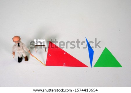 Mathematic model setup illustrating a right-angled, an obtuse-angled and an acute-angled triangle. The Professor points at the right angle.