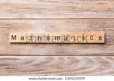 mathematic word written on wood block. mathematic text on wooden table for your desing, concept.