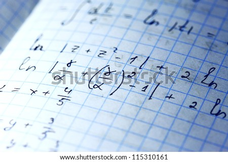 Mathematical equations hand written on paper