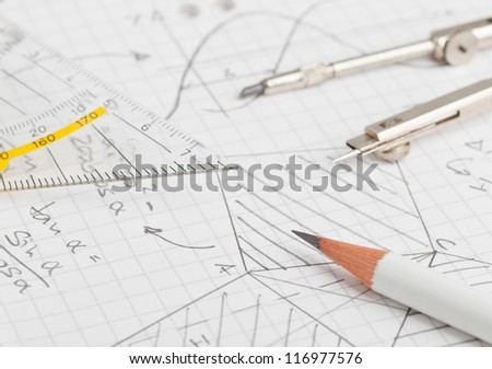 Mathematical notes about geometry and trigonometry with pencil and compass on note paper