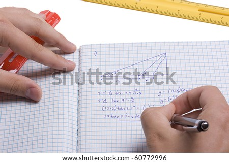 Mathematician doing a mathematic problem in a notebook. - stock photo