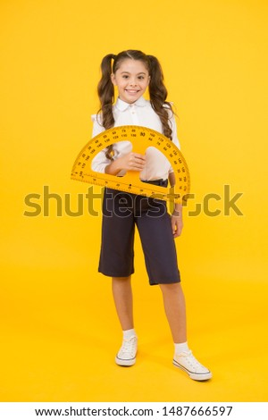 Mathematics matters. Small child holding protractor for mathematics lesson on yellow background. Cute little schoolgirl with geometrical tool for mathematics. Elementary school mathematics or maths.