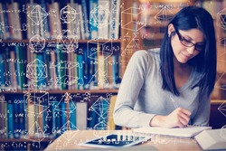 Maths against woman studying in the library