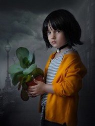 Matilda with a flower in a pot