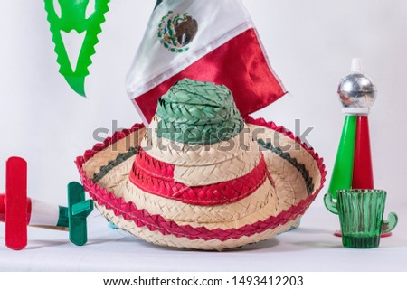Matraca, hat, mexican flag, cornet and glass of tequila on white background Stock fotó ©