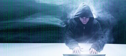 matrix style graphic image of a big data hacker with laptop code background