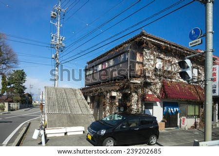 MATSUMOTO, JAPAN - DECEMBER 3, 2014: Low rise buildings, clean streets and very few cars are a common cityscape find in Japan. Strong environmental laws keeps the nation clean and green.