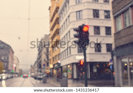 Matte Vintage. Rainy evening in the city. Drive. Traffic light. Overcast. Houses and a road. Blurred avenue scene. Blur urban background.  #1431236417