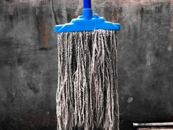 matted and hanging mop broom