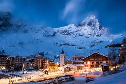 Matterhorn (Monte Cervino) mountain in moonlit blue evening. Cervina ski resort in the Alps, Valle'd Aosta, Italy