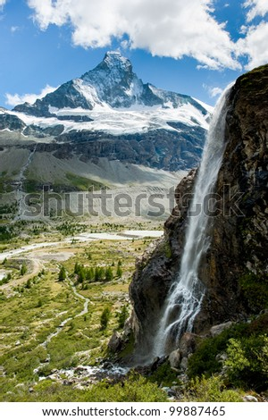 Matterhorn mountain peak with waterfall in summer, Zermatt, Switzerland