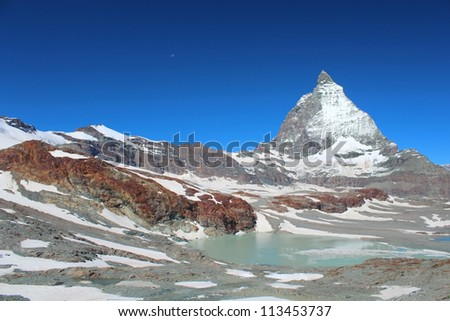 Matterhorn peak against clear blue sky. Theodul pass on the left.
