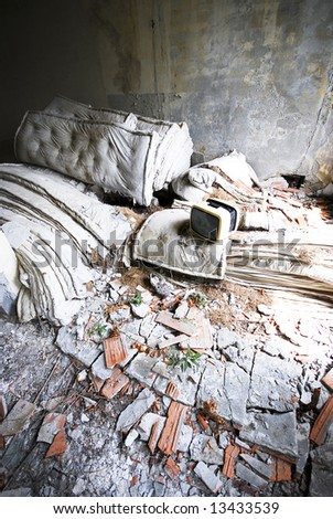 mattresses and TV in an abandoned building