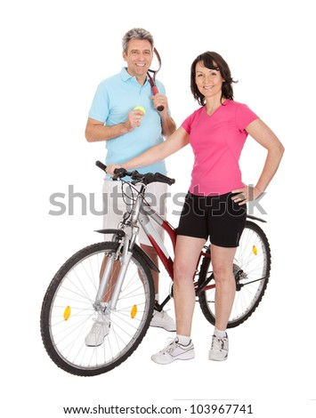 Mature active couple doing sports. Isolated on white