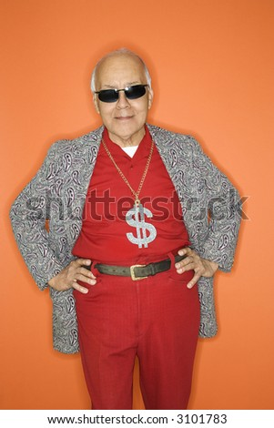 stock photo : Mature adult Caucasian male wearing money sign necklace.