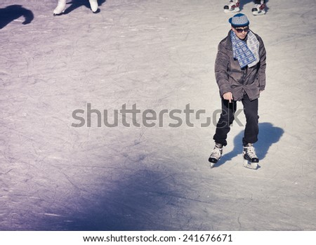 Mature adult who are ice skating at the ice rink outdoors at Medeo