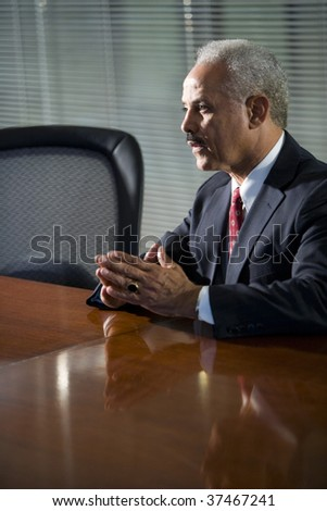 Mature African American businessman sitting at conference table