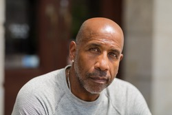 Mature African American man with a concerned look.