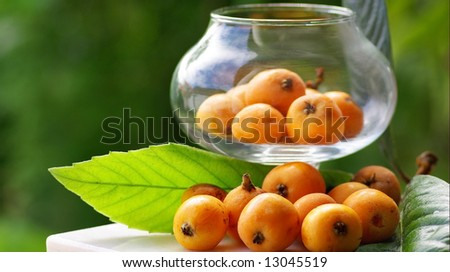 Mature and flavorful Loquats with in a glass container.
