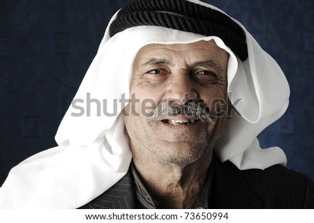 Mature Arabic man with traditional clothes - stock photo