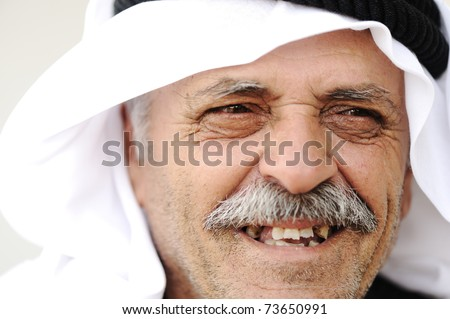 Mature Arabic man with traditional clothes, portrait