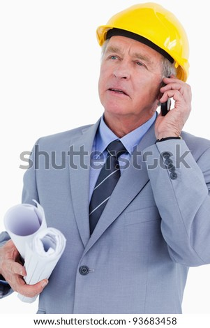 Mature architect on his mobile phone against a white background